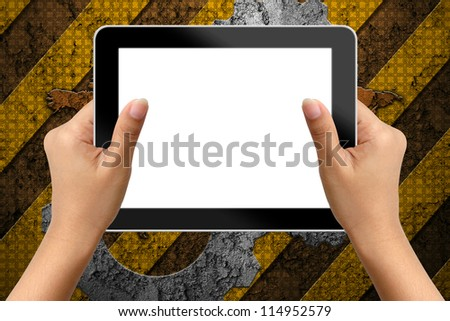 Hand of business woman holding digital tablet with blank screen on industry background