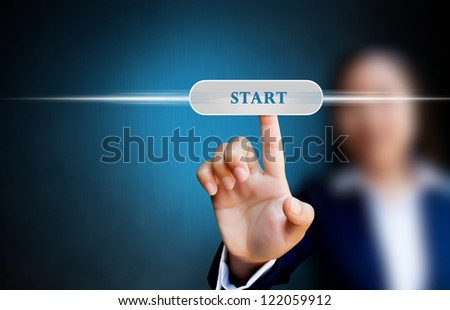 hand of business women pushing a button on a touch screen interface on start button