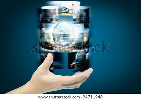 Hand of businessman hold streaming images with earth globe