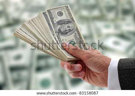 hand of businessman holding dollars