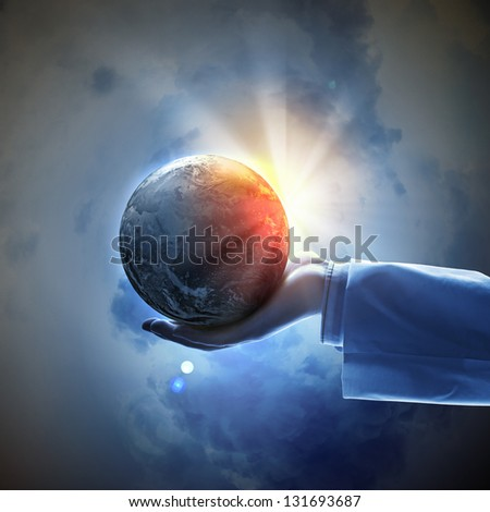 Hand of businessman holding earth planet against illustration background. Elements of this image are furnished by NASA