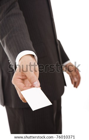 Hand of businessman offering business card on white background - stock photo