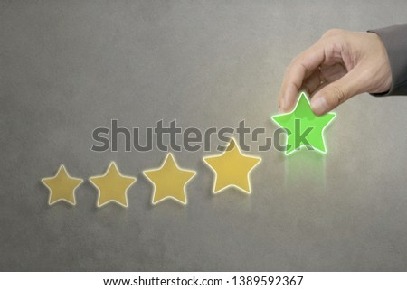 Hand of businessman Putting increase icon five star, The best excellent business services rating customer experience concept. #1389592367