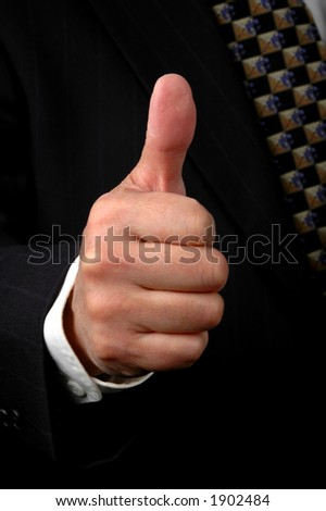 Hand of businessman showing the thumbs up symbol