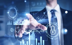 Hand of businessman using financial infographic interface in blurry office with creative double exposure effect. Concept of big data. Toned image