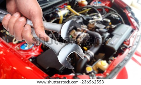 Hand of car mechanic with wrench. Auto repair service #236562553