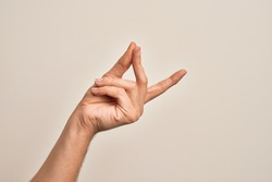 Hand of caucasian young man showing fingers over isolated white background snapping fingers for success, easy and click symbol gesture with hand