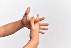 Hand of caucasian young man showing fingers over isolated white background stretching with fingers intertwined, hands together and fingers interlocked