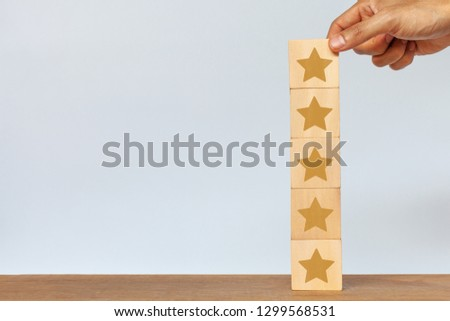 Hand of client giving a five star rating. Service rating, satisfaction concept #1299568531