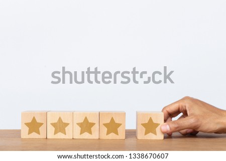 Hand of client giving a five star rating. Service rating, satisfaction concept #1338670607