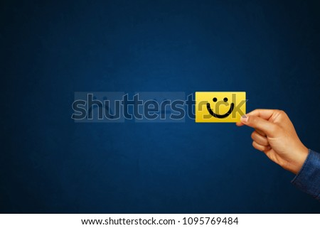 Hand of client show a feedback with smiley face card. Service rating, satisfaction concept #1095769484