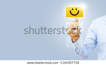 Hand of client show a feedback with smiley face card. Service rating, satisfaction concept #1164307738