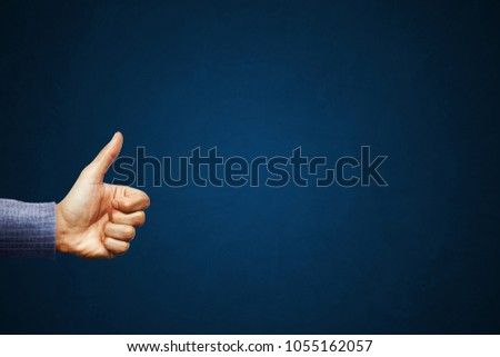 Hand of client show thumb up on blue background. Service rating, satisfaction concept