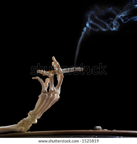 Hand of death holding a smoking cigarette