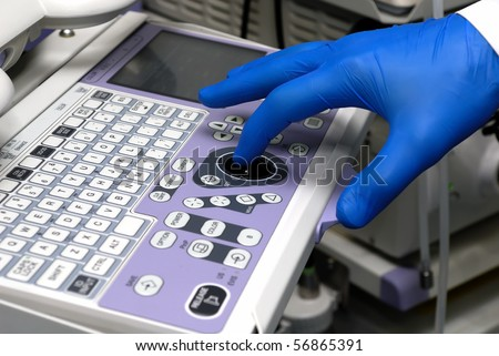 Hand of doctor managing medical equipment