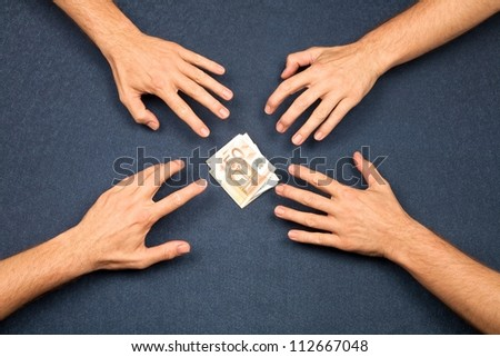 hand of four men and wad of euros on blue background