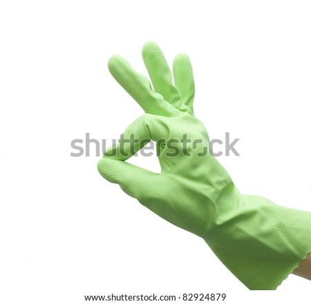 Hand of housewife in a green kitchen glove gesturing OK isolated on white background