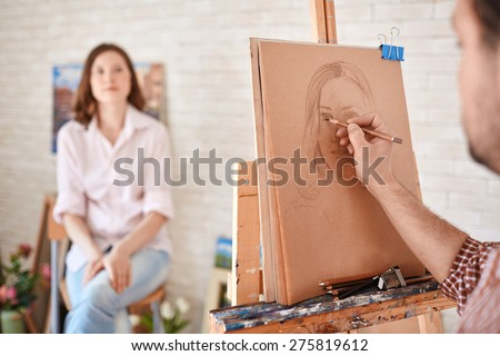 Hand of male artist drawing his muse #275819612