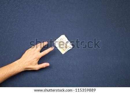hand of man and wad of euros on white background