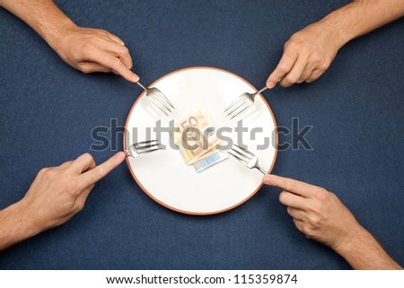 hand of man and wad of euros on white plate