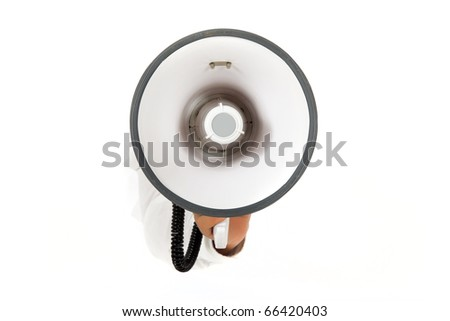 Hand of man breaking through a paper wall holding megaphone. Copy space. Studio shot. White background.