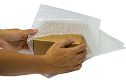 hand of man hold Bubbles covering the box by bubble wrap for protection product cracked  or insurance During transit -isolated white background