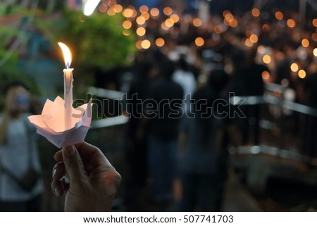 Hand of man hold candle flame light at night with bokeh background #507741703