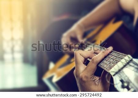 hand of man in classical guitar #295724492