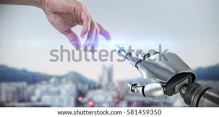 Shutterstock Hand of man pretending to touch an invisible screen against blur view of harbour