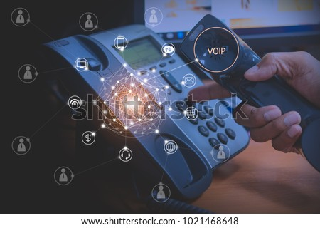 Hand of man using ip phone with flying icon of voip services and people connection, voip and telecommunication concept Zdjęcia stock ©