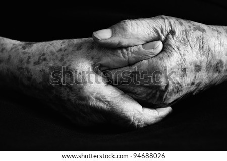 Hand of old woman in black and white - stock photo