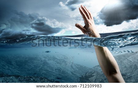 Hand of person drowning in water Stock photo ©
