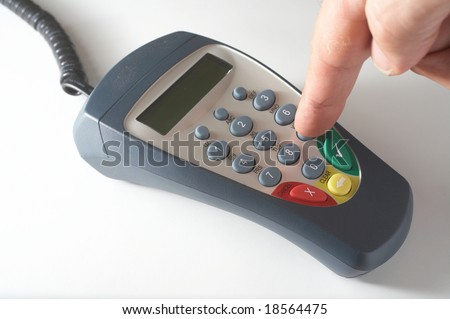Hand of person using debit card terminal pinpad
