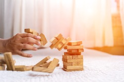 Hand of pulling wood block fail on building tower at home and drape change, choice business risking dangerous project plan failure construction,Selective block wooden