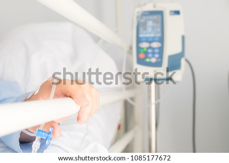 hand of senior person in a hospital bed