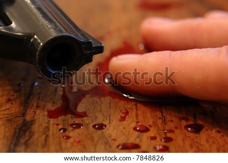 hand of teenager who committed suicide from a bullet of revolver...