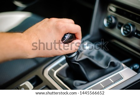 Hand of the driver on the gear knob in the car. Transport concept and manual transmission. Driving, transmission failure. #1445566652