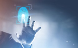 Hand of unrecognizable businessman in suit standing in blurred office and touching glowing dactylogram interface. Id and authentication concept. Toned image double exposure copy space
