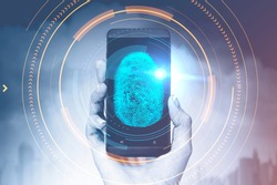 Hand of woman holding a smartphone with glowing dactylogram interface and hud over cityscape background. Id and authentication concept. Toned image double exposure copy space