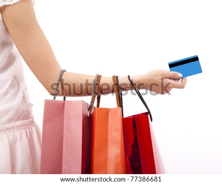 hand of woman holding shopping bags and credit card