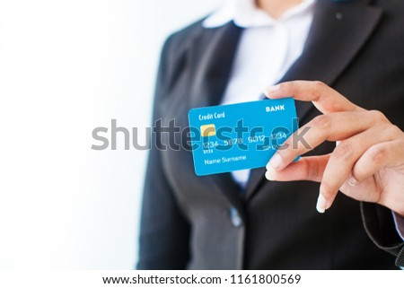 Hand of woman in formals holding credit or debit card  #1161800569