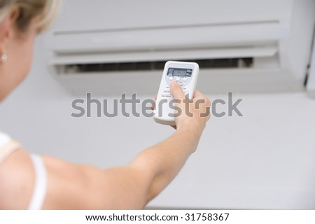 Hand of woman includes air-conditioner