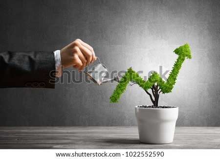 hand of woman watering small...