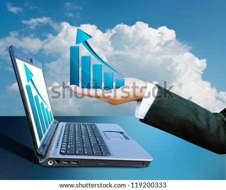 Hand of women business graph on computer background - stock photo