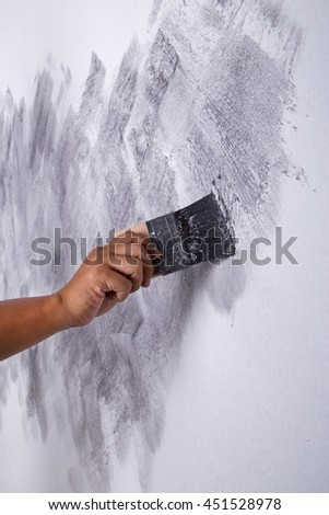 hand of worker use brush for color paint concrete Loft style on wall #451528978