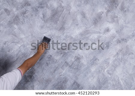 hand of worker use brush for color paint concrete Loft style on wall #452120293