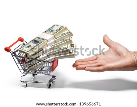 Hand offers shopping cart full of money stacks
