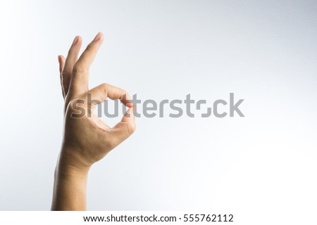 hand ok sign on white background #555762112