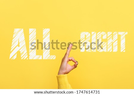 hand ok sign with all right inscription over trendy yellow background Сток-фото ©