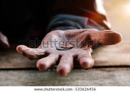 hand old man begging for money because of the hunger in morning light